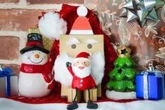 Felicidad del juguete de Santa Claus en día de la Navidad Foto de archivo