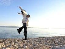 Felicidad en la playa Imagen de archivo libre de regalías
