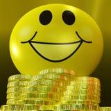 Felicidad monetaria de Smiley Face With Coins Showing Fotografía de archivo