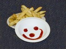 A felicidade é ketchup e frita Fotografia de Stock Royalty Free