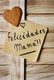 文本felicidades妈妈妈妈,congrats用西班牙语 免版税图库摄影
