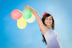 Felicity with Balloons and Blue Sky Stock Photo