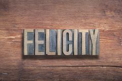Felicity word wood. Felicity word combined on vintage varnished wooden surface royalty free stock photos
