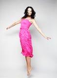Felik flygflicka i rosa klänning Fotografering för Bildbyråer