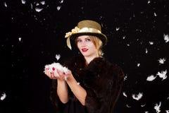 Felik kvinna i fjäderregn royaltyfria foton