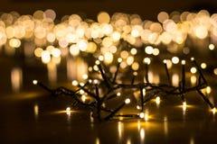 Felika ljus för julgranen med oskarp bakgrund Fotografering för Bildbyråer