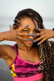 Feline black woman showing funny nails Stock Photography