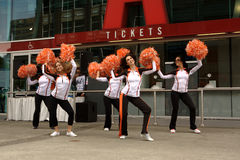 Felions, Cheerleaders of the BC Lions. The Felions, the cheerleaders of the BC Lions, a member team of the Canadian Football League (CFL), cheer outside BC Place Royalty Free Stock Photography