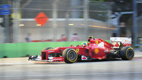Felipe Massa racing in F1 Singapore GP Royalty Free Stock Photos