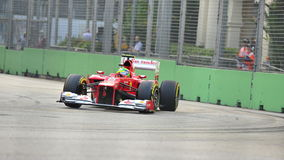 Felipe Massa racing in F1 Singapore GP Royalty Free Stock Photography