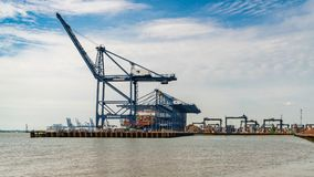 Felixstowe Harbour, Suffolk, England, UK. Felixstowe, Suffolk, England, UK - May 28, 2017: The Port of Felixstowe with some cranes, containers and a container royalty free stock photography