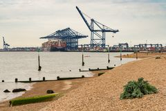 Felixstowe Harbour, Suffolk, England, UK. Felixstowe, Suffolk, England, UK - May 28, 2017: The Port of Felixstowe with some cranes, containers and a container stock image