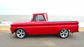 Classic Red  Chevrolet pickup truck on seafront promenade. Royalty Free Stock Photo
