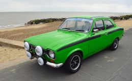 Classic Green Ford Escort Mexico  Motor Car Parked on seafront promenade. Royalty Free Stock Photo