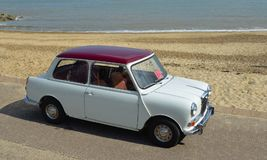 Classic Red  & white Wolseley Mini  Car  parked on seafront promenade Stock Photography