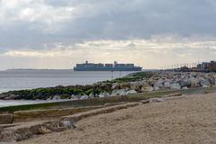 FELIXSTOWE, UNITED KINGDOM - JAN 27, 2019: Thalassa Doxa container ship at Felixstowe seafront heading towards Felixstowe port in. Suffolk royalty free stock images