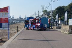 FELIXSTOWE, UNITED KINGDOM - OCTOBER 20, 2018 - Seafront train d. Riving along the prom with people on-board stock photos