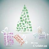 Feliz árbol de navidad con los regalos en nieve Foto de archivo libre de regalías