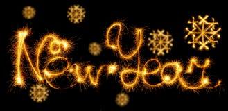 Feliz Año Nuevo con el copo de nieve hecho con las chispas en negro Imagen de archivo libre de regalías