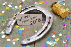 Feliz Año Nuevo 2016 con el zapato del caballo Fotos de archivo