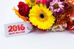 Feliz Año Nuevo 2016 con la flor y la etiqueta aisladas en un fondo blanco Fotografía de archivo