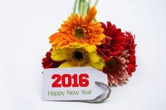 Feliz Año Nuevo 2016 con la flor y la etiqueta aisladas en un fondo blanco Imágenes de archivo libres de regalías