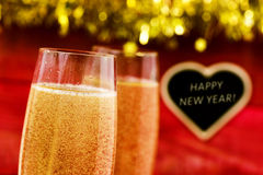 Feliz Año Nuevo de Champán y del texto Fotografía de archivo libre de regalías