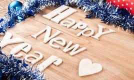 Feliz Año Nuevo de la inscripción de madera Fotografía de archivo libre de regalías