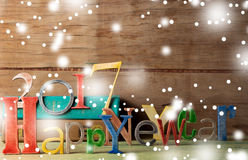 Feliz Año Nuevo de la inscripción de madera Imagen de archivo libre de regalías
