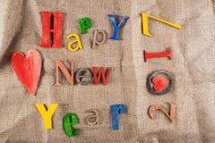 Feliz Año Nuevo de la inscripción de madera Imagen de archivo