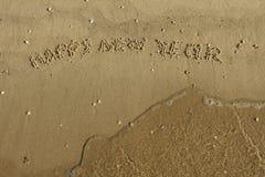 Feliz Año Nuevo de la inscripción en la arena Fotografía de archivo