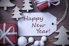 Feliz Año Nuevo del árbol del regalo de la etiqueta de la Navidad Imágenes de archivo libres de regalías