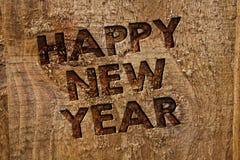 Feliz Año Nuevo del texto de la escritura de la palabra El concepto del negocio para feliz Navidad de la enhorabuena todo el mund Foto de archivo libre de regalías