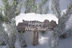 Feliz Año Nuevo del texto de la rama de árbol de abeto de la nieve de la muestra de la Navidad Imagen de archivo libre de regalías