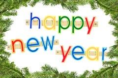 Feliz Año Nuevo del texto del saludo en blanco en un marco hecho de picea Fotos de archivo libres de regalías