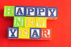 Feliz Año Nuevo deletreada con los bloques del alfabeto Fotos de archivo