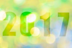 Feliz Año Nuevo 2017 en el bokeh abstracto de la luz Imagen de archivo libre de regalías