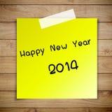 Feliz Año Nuevo 2014 en el papel pegajoso Foto de archivo
