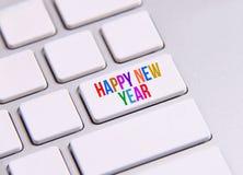 Feliz Año Nuevo en el teclado Imagenes de archivo