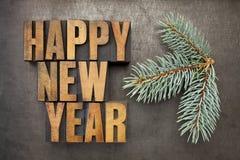 Feliz Año Nuevo en el tipo de madera Imagen de archivo libre de regalías