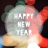 Feliz Año Nuevo en fondo colorido del bokeh Fotografía de archivo