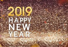 Feliz Año Nuevo 2019 en fondo del brillo del extracto del color oro, H Fotos de archivo