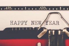 Feliz Año Nuevo en la máquina de escribir vieja Fotografía de archivo
