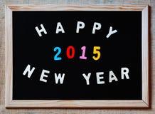 Feliz Año Nuevo 2015 en la pizarra Foto de archivo libre de regalías
