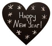 Feliz Año Nuevo en la pizarra de la forma del corazón imagen de archivo