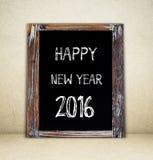 Feliz Año Nuevo 2016 en la pizarra del vintage Imagen de archivo