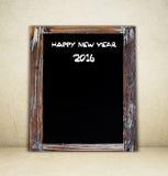 Feliz Año Nuevo 2016 en la pizarra del vintage Imagen de archivo libre de regalías