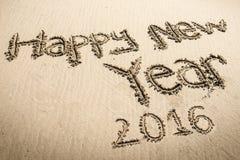 Feliz Año Nuevo 2016 en la playa Foto de archivo