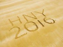 Feliz Año Nuevo 2016 en la playa de la arena Imagen de archivo libre de regalías
