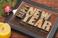 Feliz Año Nuevo en la tableta digital Fotos de archivo libres de regalías